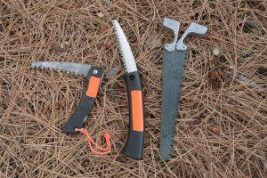 I prefer a quality saw over a hatchet in most survival situations. Here are three different types of saws I carry as the need dictates: From left, is a Gerber folder; a Fiskar sliding blade, and a double-edged Pac-Saw Wyo.