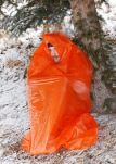 This photo demonstrates how a trash bag can be used as a quick, effective emergency shelter. (Peter Kummerfeldt photo)