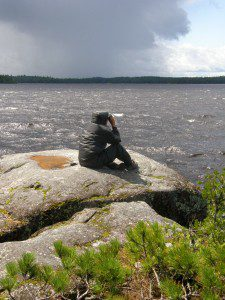 Bob waits for the storm to blow over at Lake Agnes.