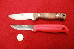 The C.T. Fischer Bushcraft knife is my pet custom knife, but the J. Marrttini utility knife below it is equally useful as a small game knife.