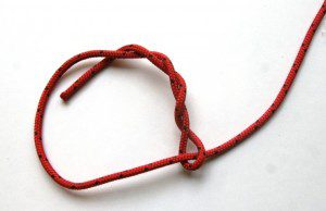 This timber hitch knot is effective for securing one end of a tarp. The harder it's pulled the more secure it gets. The knot is easy to untie.