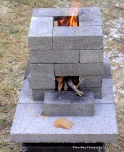 A properly- constructed rocket stove will produce an efficient cooking flame, using a fraction of the fuel of a regular campfire.