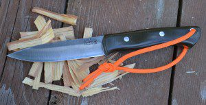 This Bark River Aurora will be easier to see with the fluorescent, reflective paracord attached to the handle.