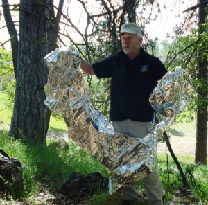 Survival expert Skip Stoffel demonstrates how fragile a mylar blanket is in a survival situation. (Blake Miller photo)