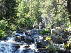 Blake Miller's sons pose at a waterfall in the backcountry.